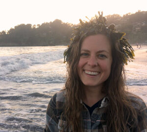 Headshot of Julia Elkin, Project Development Analyst for the California Coastal Conservancy, with a seaweed crown on head