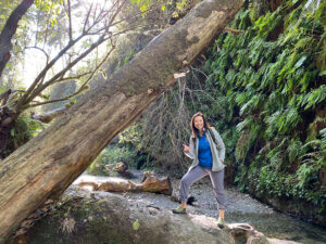 Photo of Adeline Yee hiking in Fern Canyon at Prairie Creek Redwoods State Park.